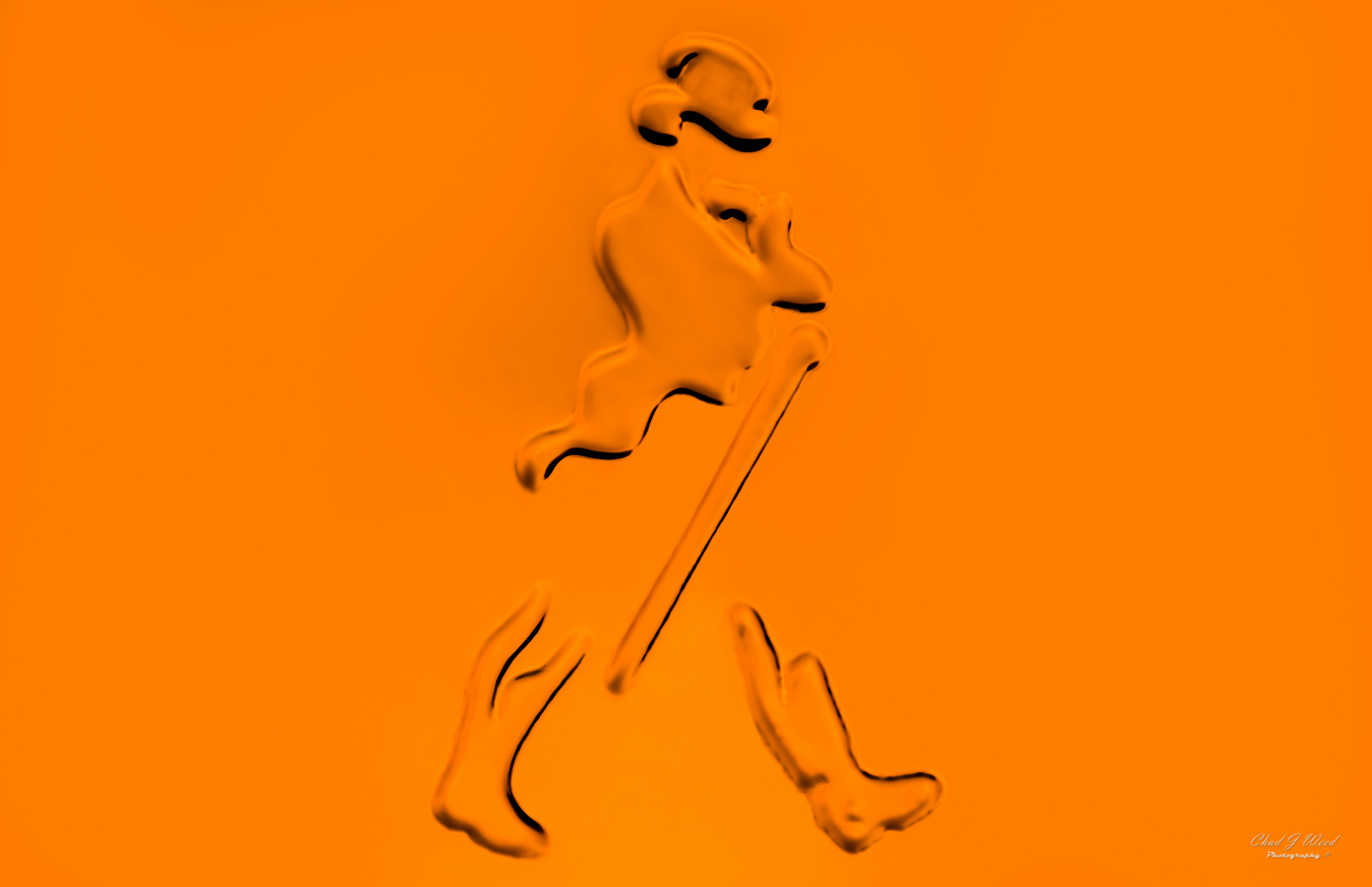 Johnnie Walker Scotch Walking Man Logo by Arizona Commercial Beverage Photographer Chad J Weed