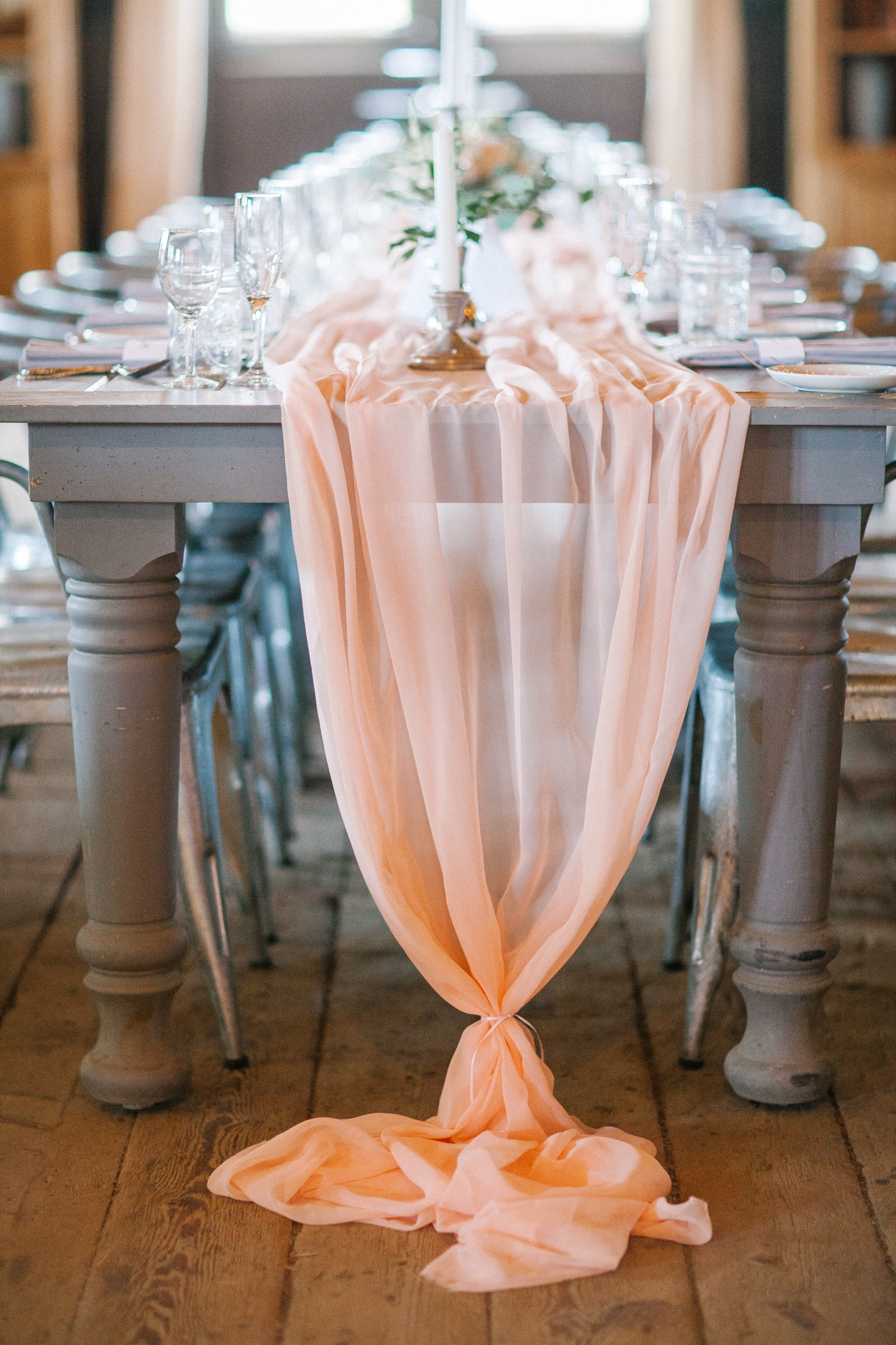 Terrain at Styers wedding with peach chiffon table runner