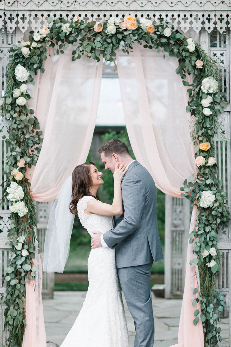 Ceremony arch with flowers and blush fabric | Terrain wedding with blush accents | Wedding planner & wedding designer: Heart & Dash | Photo: Svetlana Photography | Florals: Devon & Pinkett