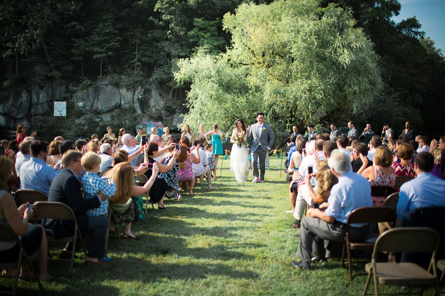 Lakeside ceremony at summer camp wedding in Pennsylvania at Camp Green Lane in the Poconos | Wedding planner: Heart & Dash | Photo: Jessica Osber Photography