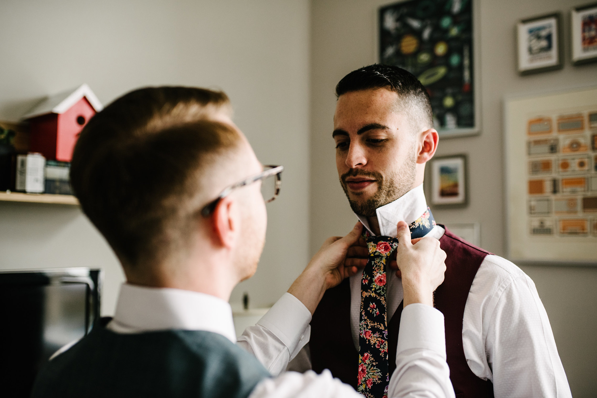 Two grooms getting ready for their wedding together with Pennsylvania wedding planner Heart & Dash and photos by AGP Collective