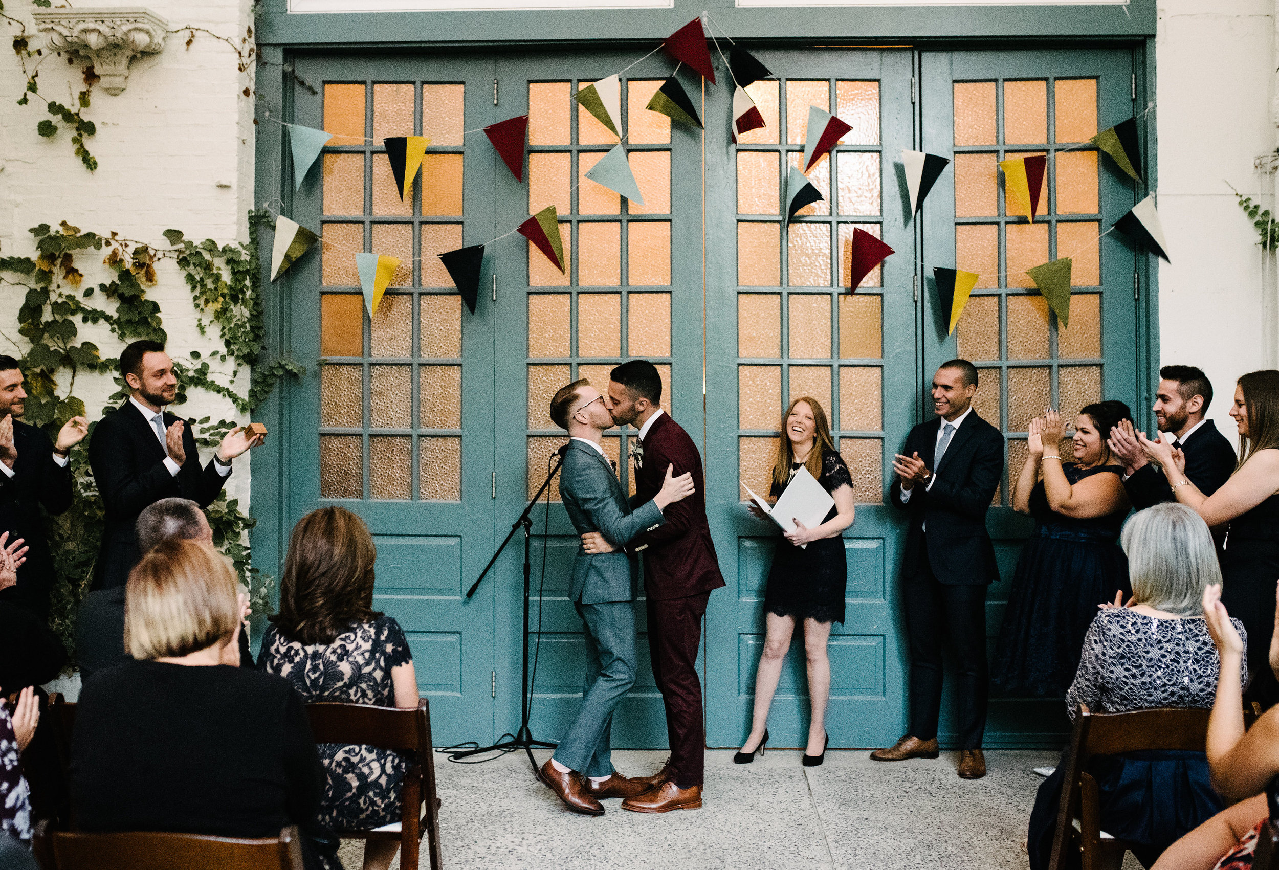 Colorful DIY wedding with bunting at Maas Building in Fishtown Philadelphia with wedding planner Heart & Dash and photos by AGP Collective