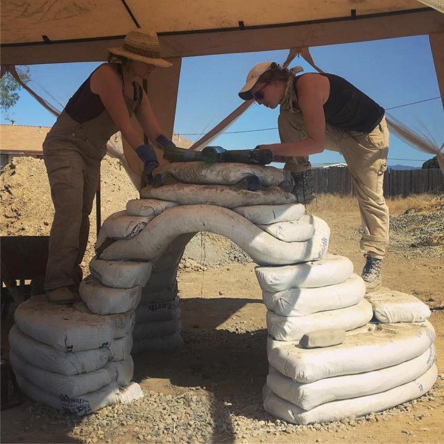 Been working on a few outdoor super-adobe sculptures the last two weeks in the backyard of the Family Resource Center here in New Cuyama with my friend and fellow artist Laura Smith. We are building a small 4ft dome and a big 10ft lizard with stabilized sandbags and recycled bottles!! The cob benches in front of the center (in the last photo) were made by some folks @quail_springs who are also helping us out with the project. Our sculptures will be part of a larger permaculture garden and be used for play + rest. Today we had our first workshop where a few local families and children came and helped bag a large retaining wall around the site. I look forward to plastering our work this coming week and seeing these creations come to life 🌀