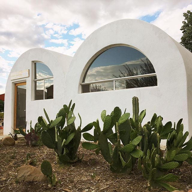"While staying @quail_springs, we swung by @blueskycenter in New Cuyama to check out the nearby triple vault built in 1988 by Nader Khalili, founder of @calearthinstitute! It was built on an old airport that was planned to be the site of 5,000 superadobe homes called the ""City of Friendship"". It would have been an amazing transformation from a former oil town into an earthen home and solar powered communtiy.  Unfortunately, the county didn't allow it, but the triple vault is still in use and affectionately called ""Khalili Cantina"" at Blue Sky Center. Felt like a full circle moment to finally see this beauty with @photosynthetik after practicing superadobe for many years and meeting each other at Cal-Earth in 2013 ✨"