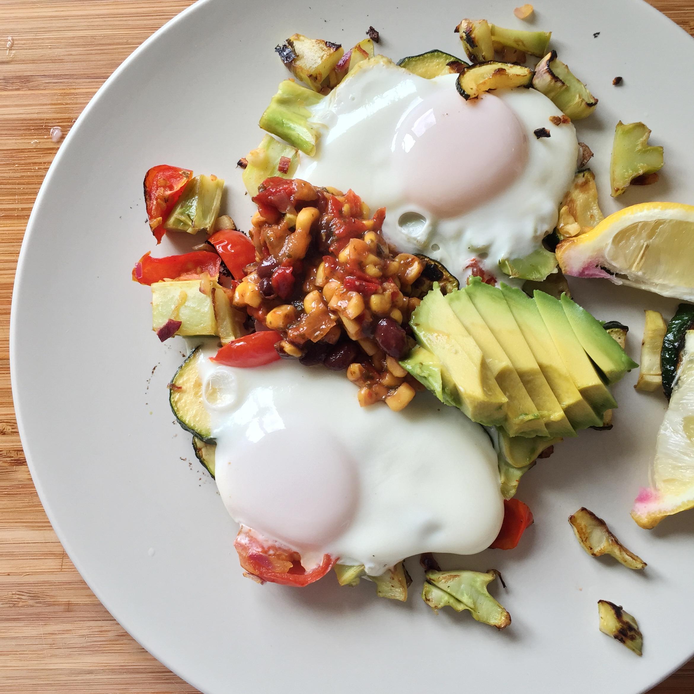Breakfast scramble using my tomatoes, broccoli stems, zucchini, & avocado, and some local eggs