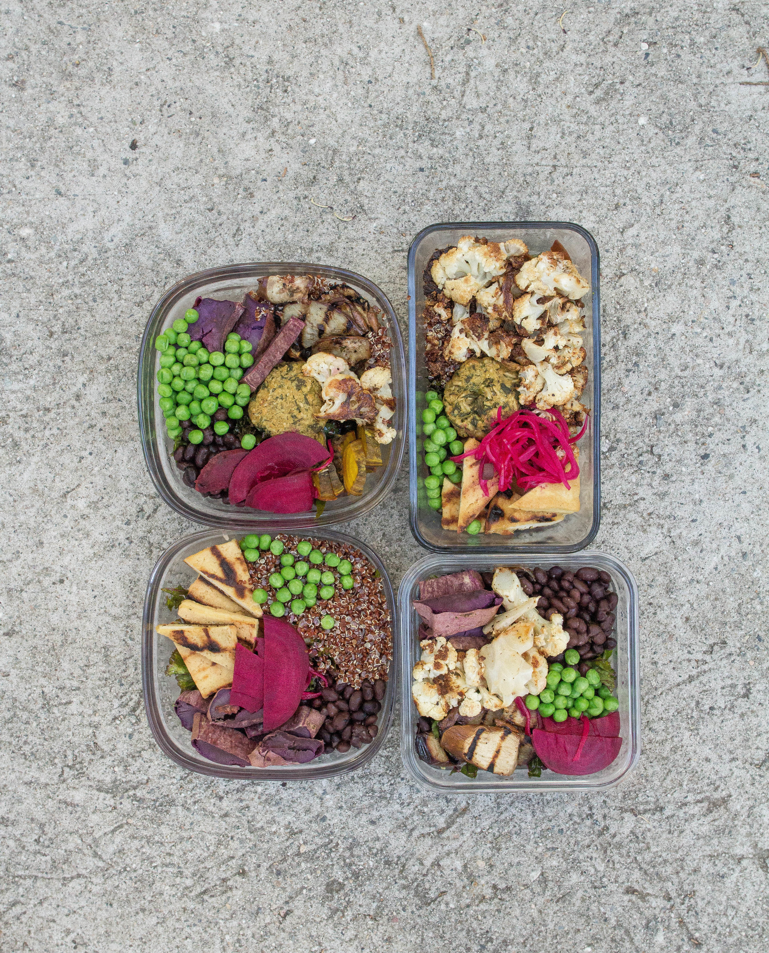 Assorted Salads for the week: roasted purple sweet potato, roasted cauliflower, falafel, black beans, quinoa, peas, grilled eggplant, roasted beets, tofu, massaged kale underneath (kale is a great meal prep trick- it's super hearty and actually tastes  better the longer you let it soak.