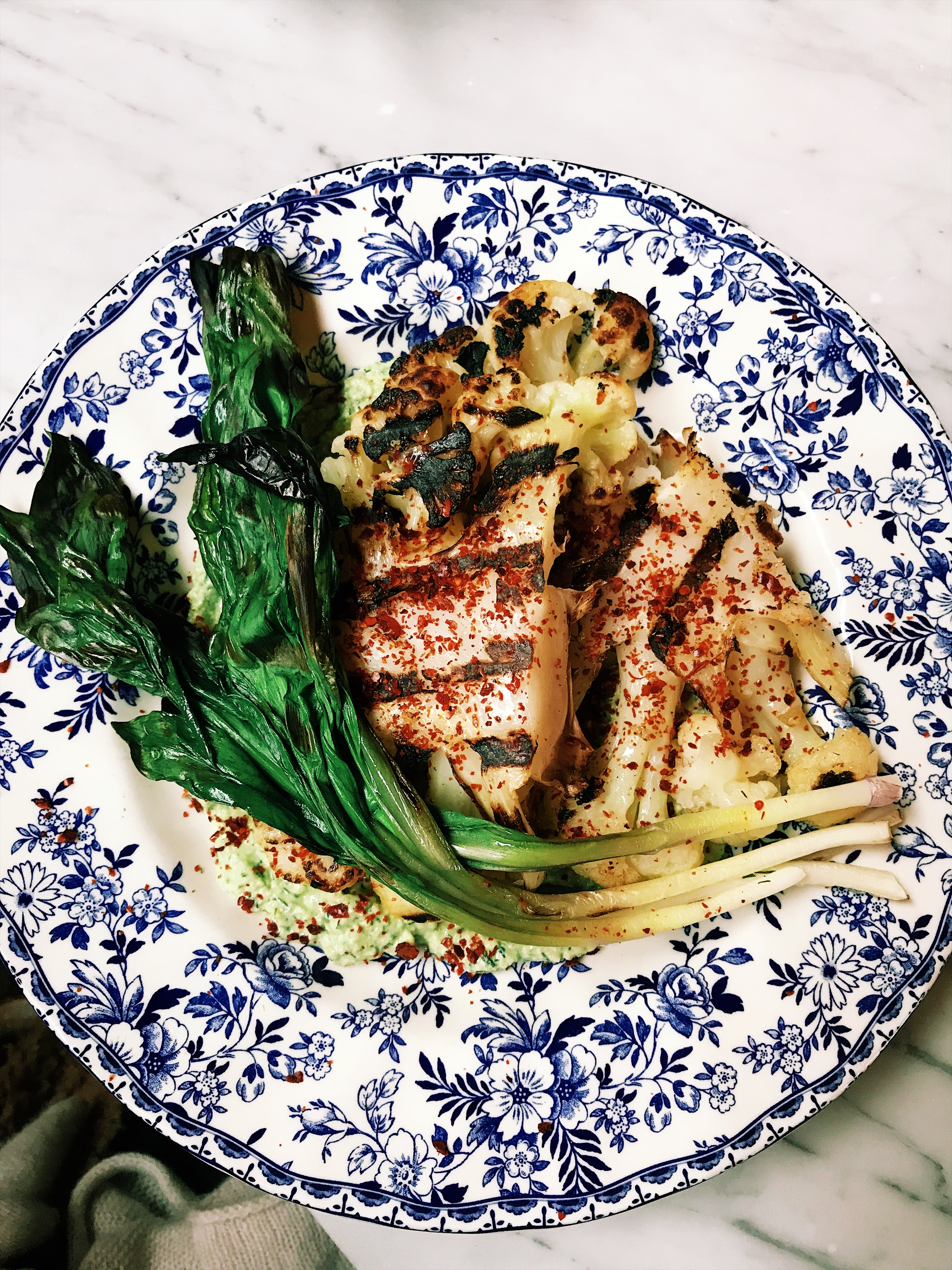 Herby cauliflower steak with grilled ramps from The Allis