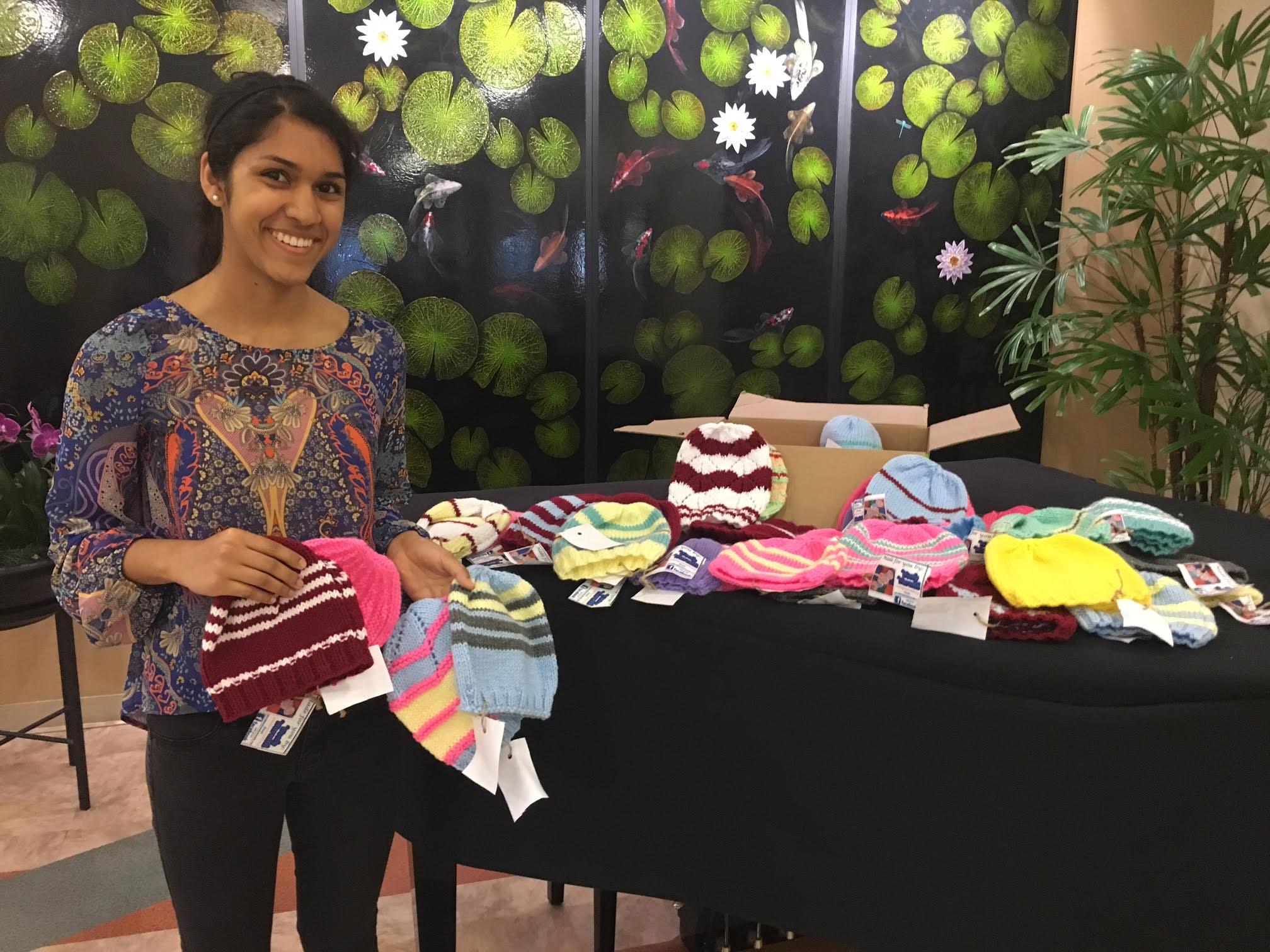 Nikita Salunke making a donation at Good Samaritan Hospital