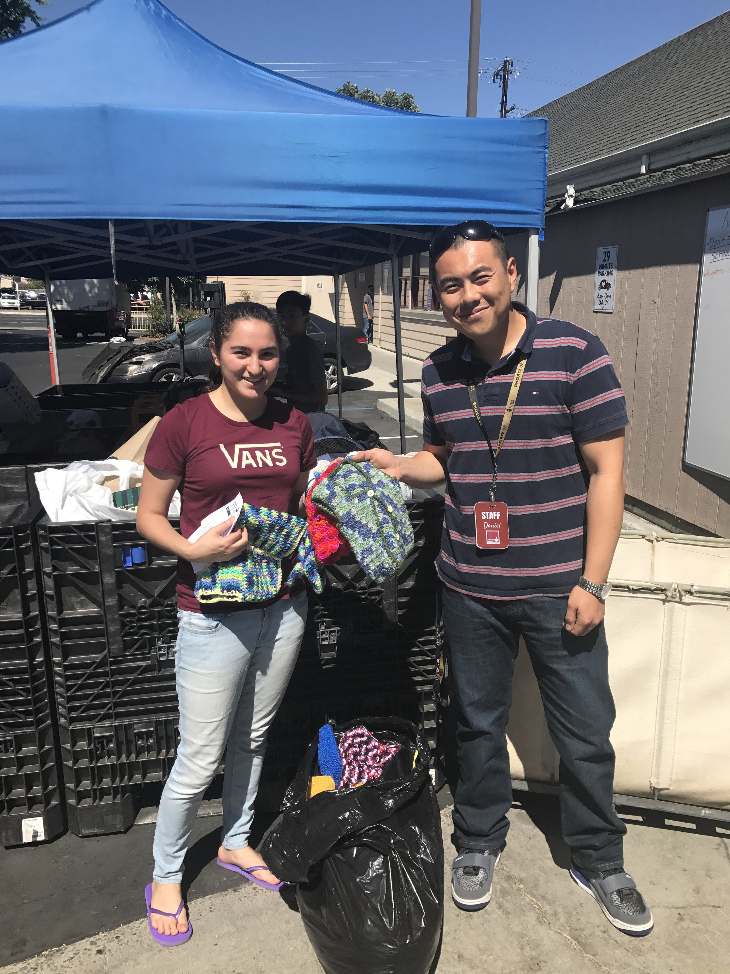 Dania making a donation at Sacred Heart Community Service