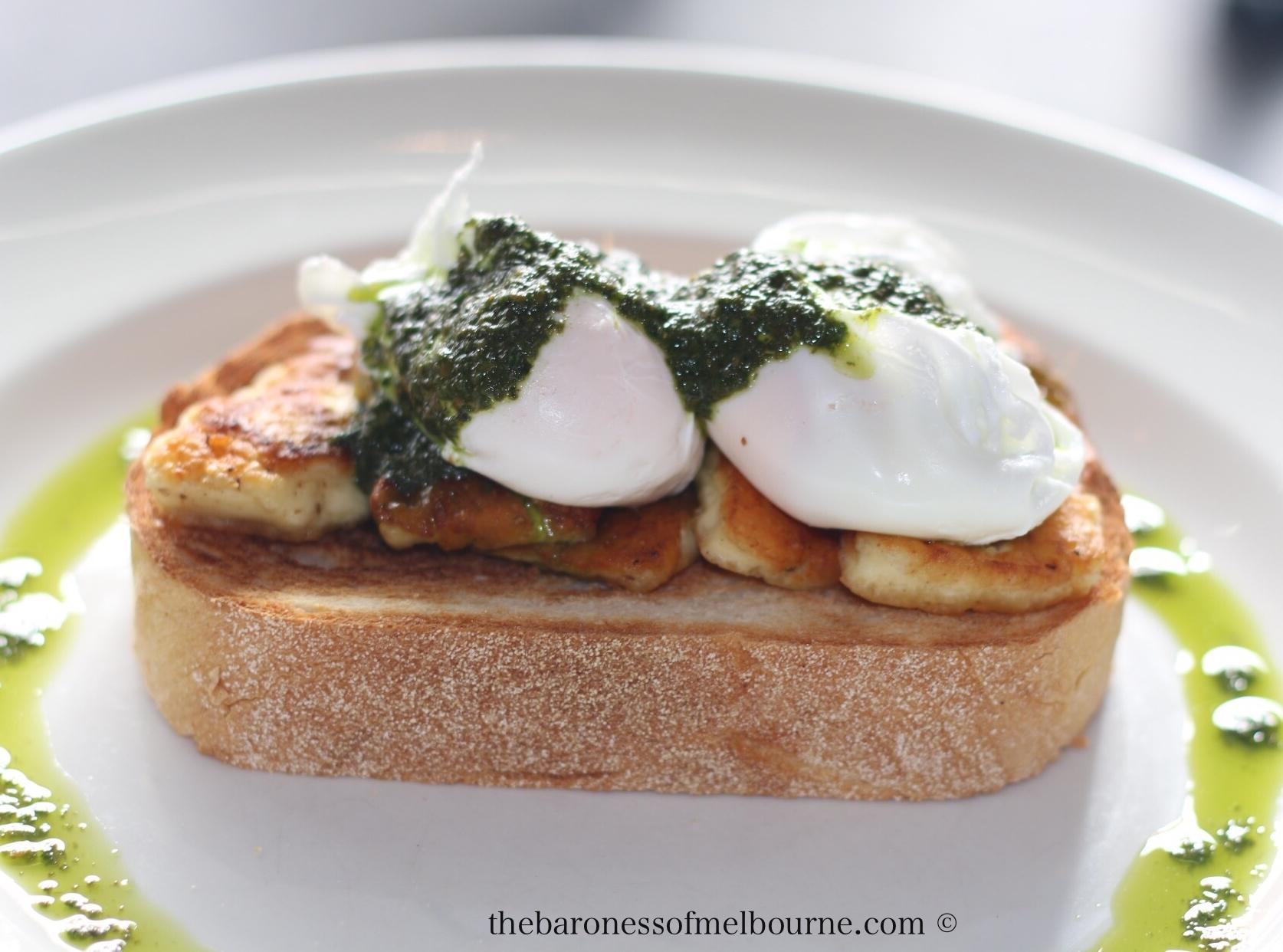 Haloumi on sour dough with poached eggs and basil pesto