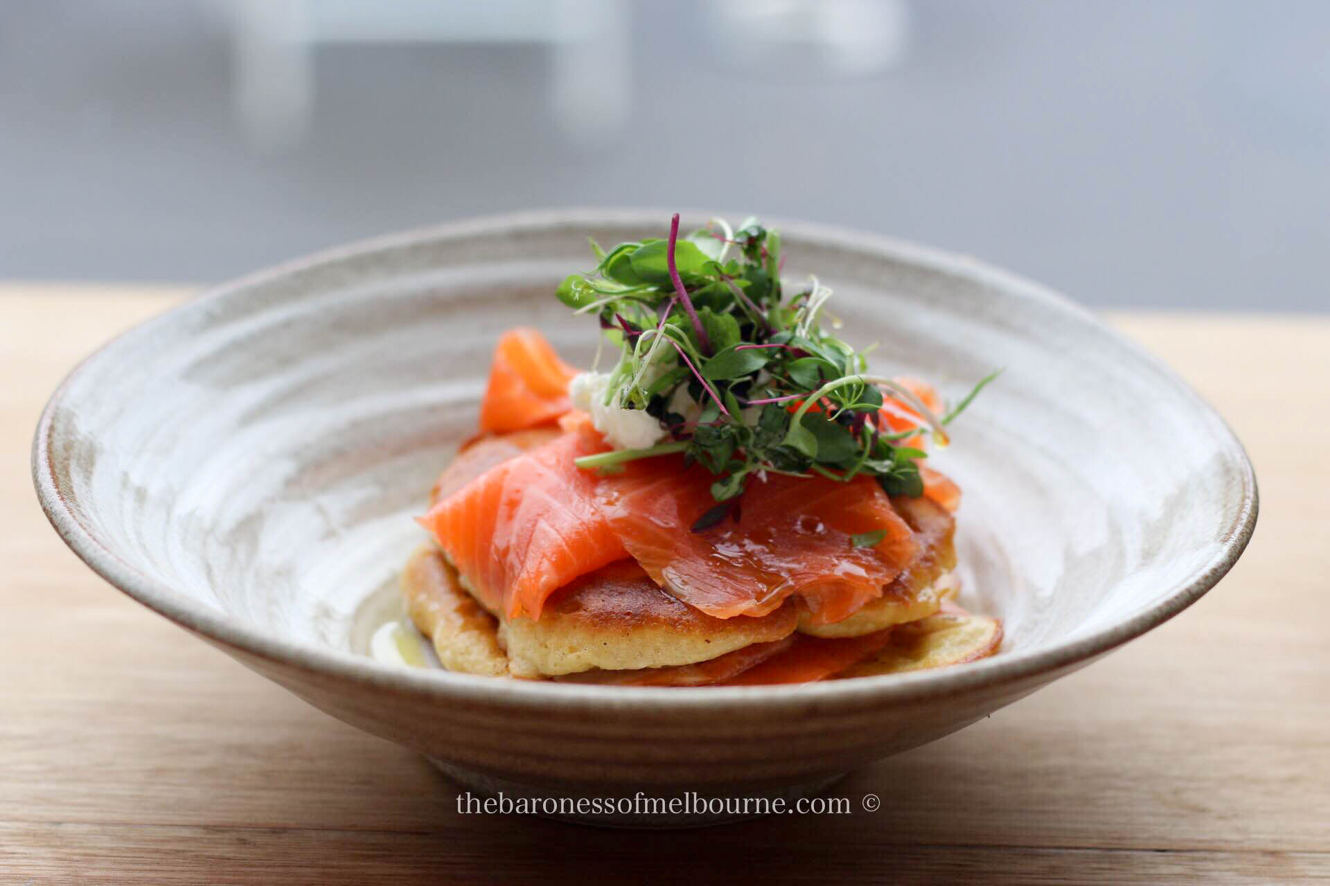 Such pretty presentation: cold smoked salmon on hot cakes