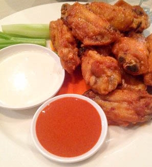 Buffalo chicken wings with original and hot sauce at The Smoke BBQ