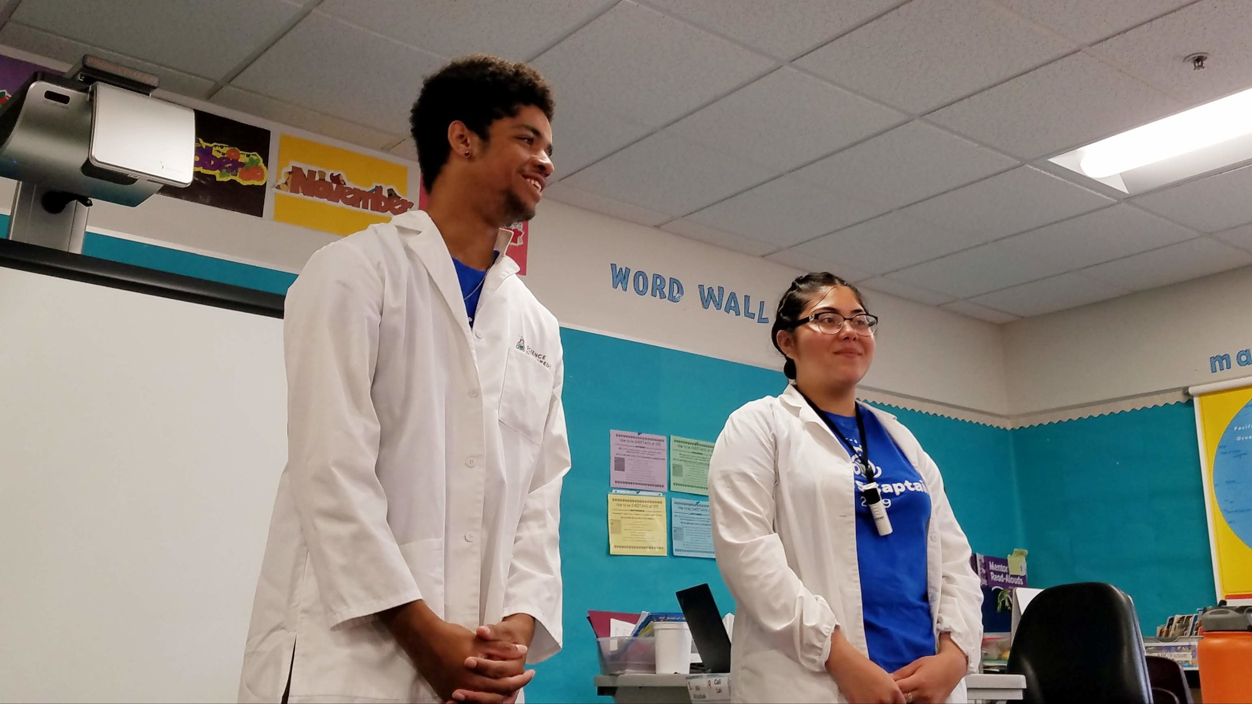 Rahmiir (left) and his partner Rosa teaching a science lab in a 1st grade classroom.