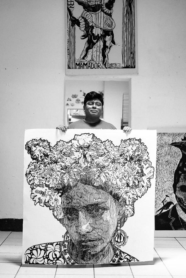 Irvine Herrera holding Ems new artwork