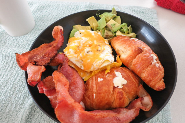 Sunday Brunch - Bacon, Eggs over Medium, 1/2 an Avocado, and Warm Croissants, with Green Tea