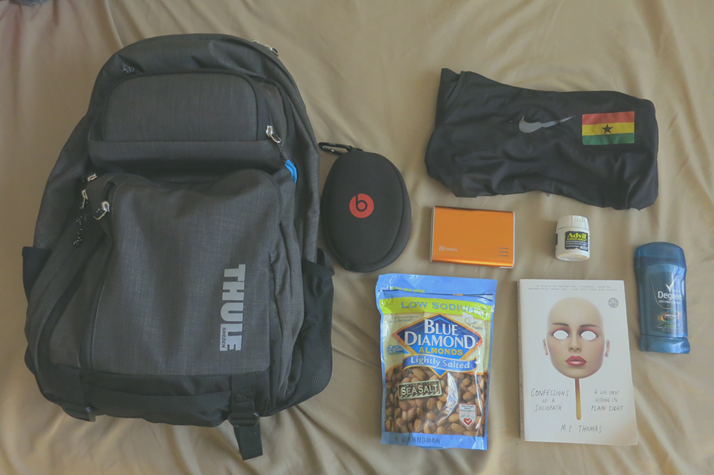 Backpack:  headphones, portable charger, snacks, ibuprofen, deodorant, track kit essentials (top, shorts, spikes), passport(s),                                          some sort of entertainment (i.e. a book)