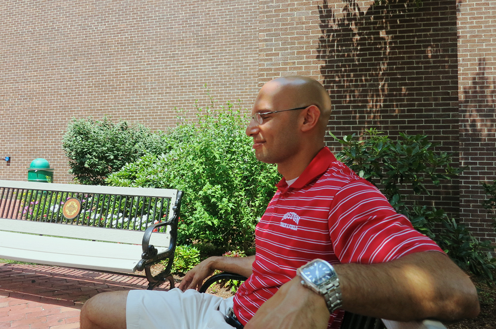Coach Sanders soaking up the rays during one of my rests.
