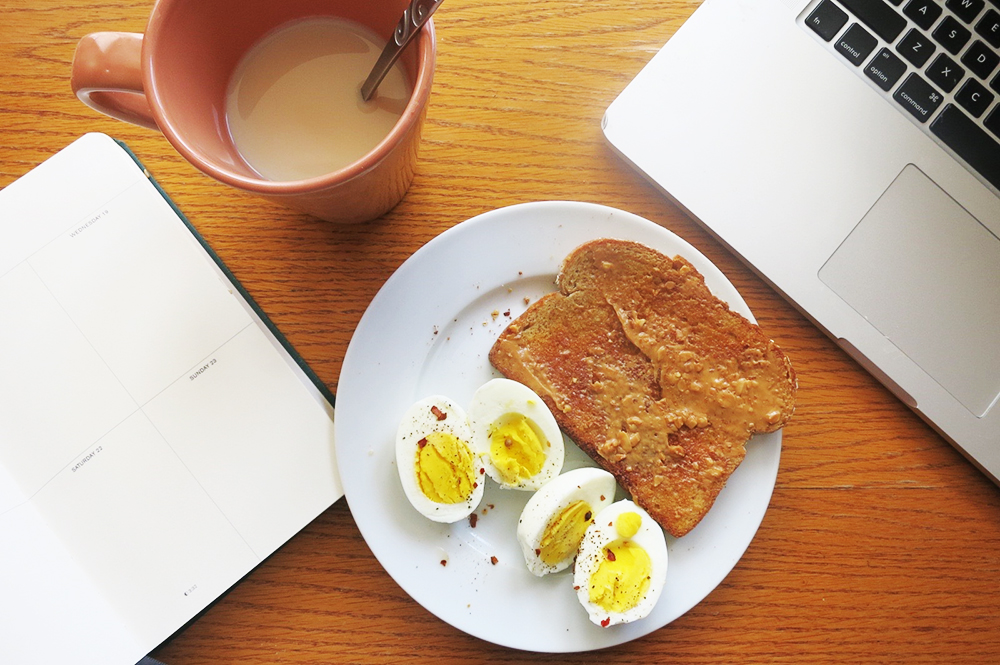 whole wheat toast with chunky almond butter and two boiled eggs