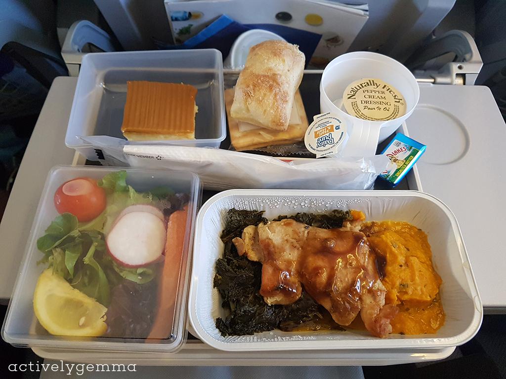 Scandinavian Airline (SAS) in-flight meal - chicken, kale?, salad, cheesecake