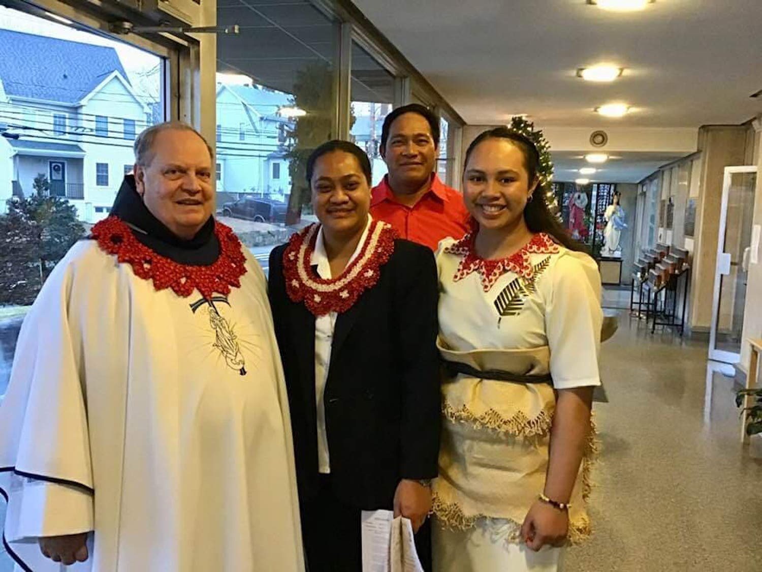 Before the Mass: Father Dennis Wheatley OFM, pastor, with Sister Senitila and Viliame and his daughter Tatila, who came from New Zealand.