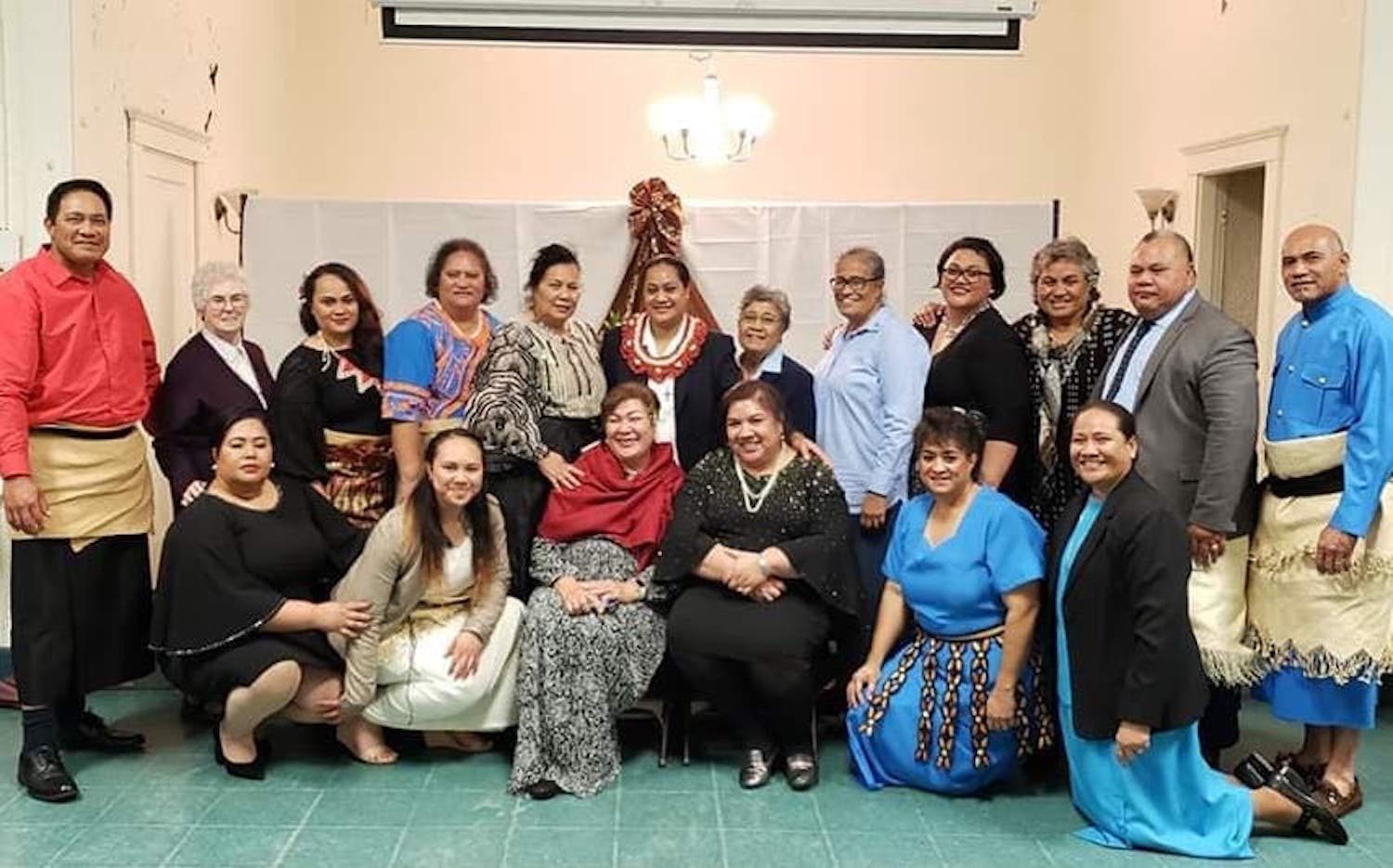 Sister Senitila (center) with family members and some of the Sisters who gathered in the parish hall for the celebration after the Mass.