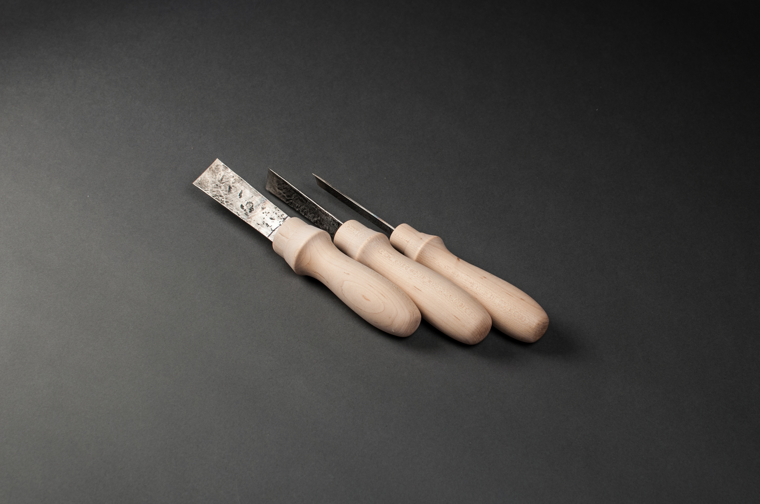 Hand-turned maple handles. McCurdy acquired a set of hand forged chisels and gauges in Bali in 2011. She made handles for three of them in 2016 to demonstrate capability on a wood lathe.
