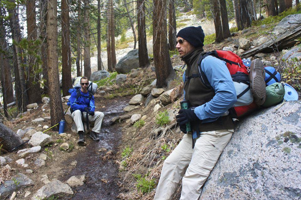 hiker-resting-on-rock