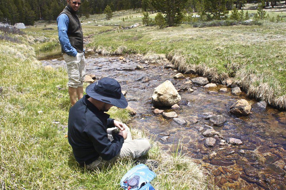 boy-filtering-water-at-stream