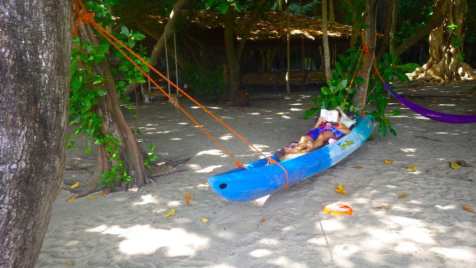 girl-reading-on-kayak