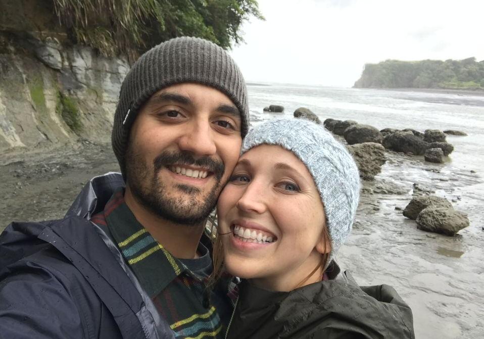 couple-smiling-tongaporutu-new-zealand-north-island