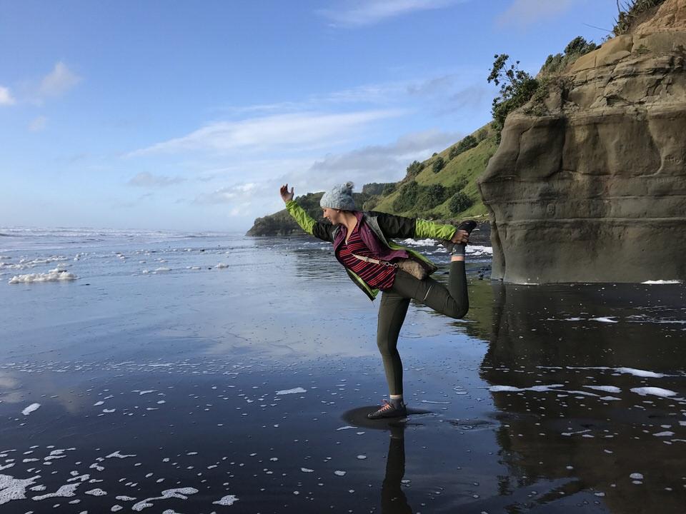 girl-yoga-pose-on-the-beach-Mokau-new-zealand-north-island