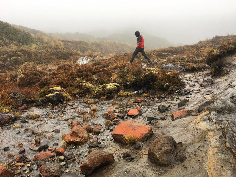 man-walking-tongariro-new-zealand-north-island