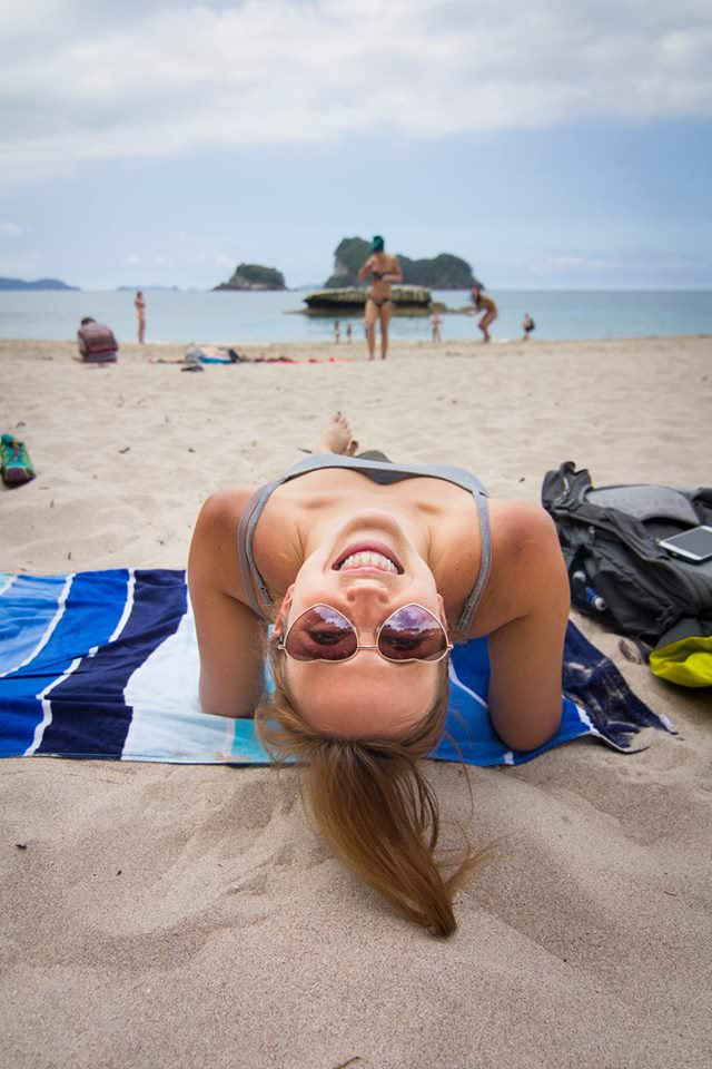 girl-on-beach-cathedral-cove-new-zealand-north-island