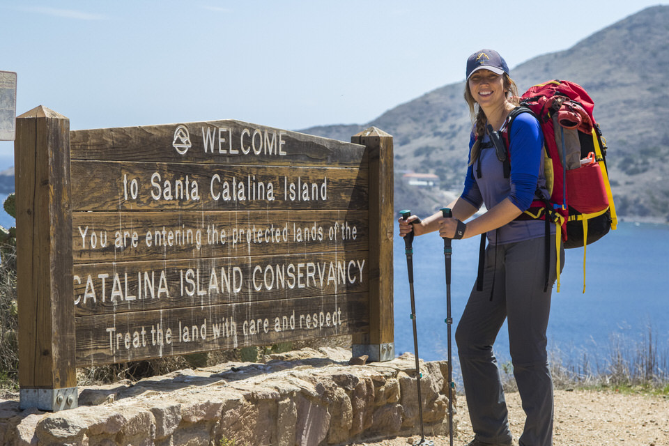 hiker-next-to-welcome-catalina-island-sign