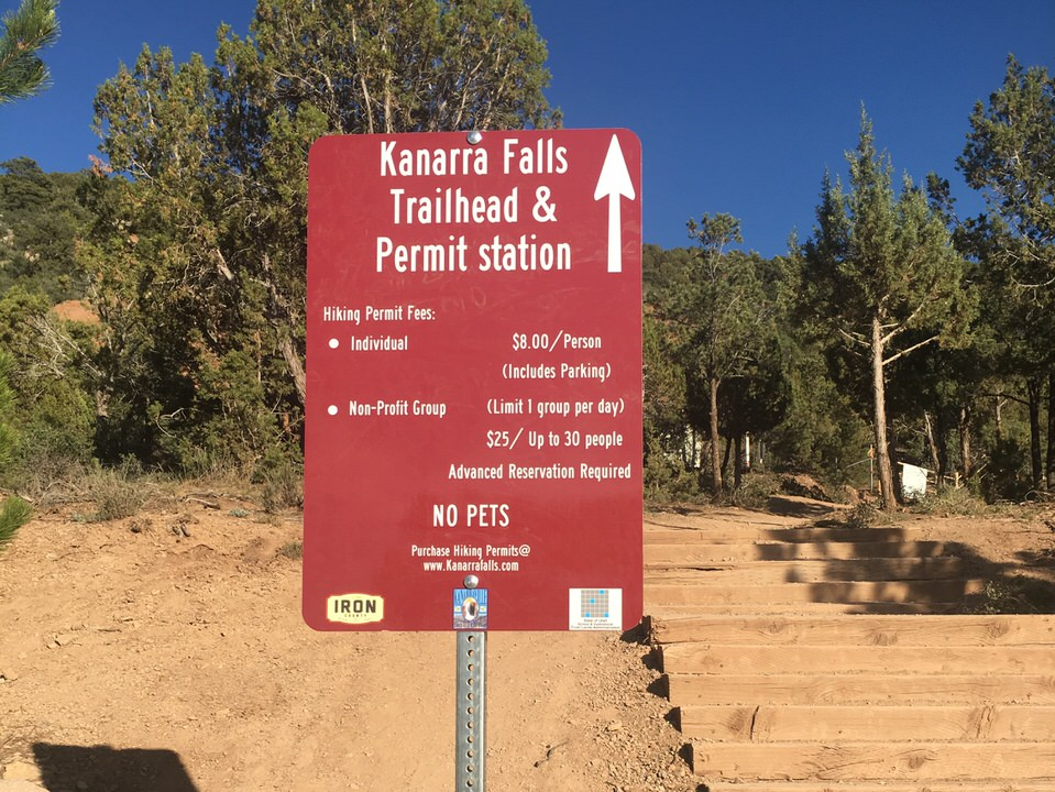 Trailhead sign at Kanarra Falls showing the permit fees for this trail.
