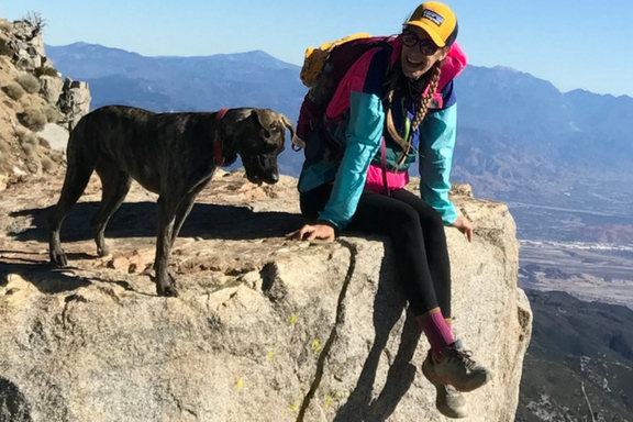 Girl and dog at Cucamonga Peak