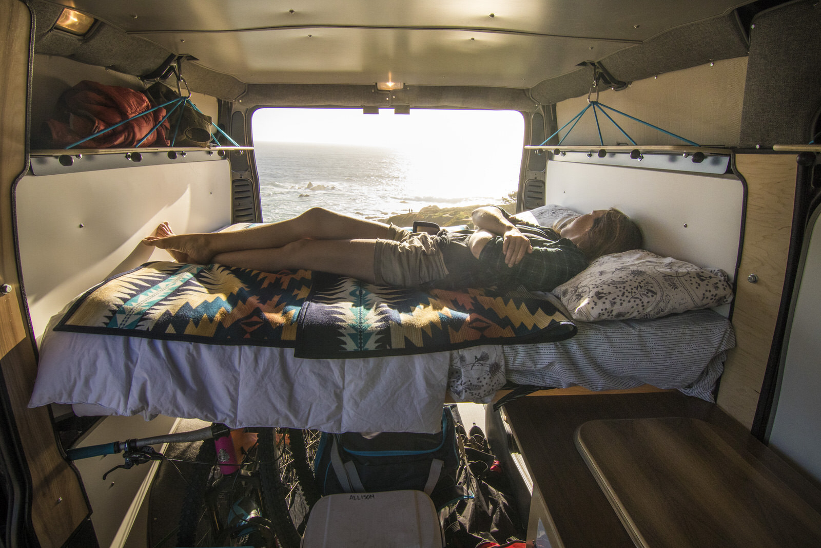 Laying down on the Wafarer Van bed with a great view of the ocean.
