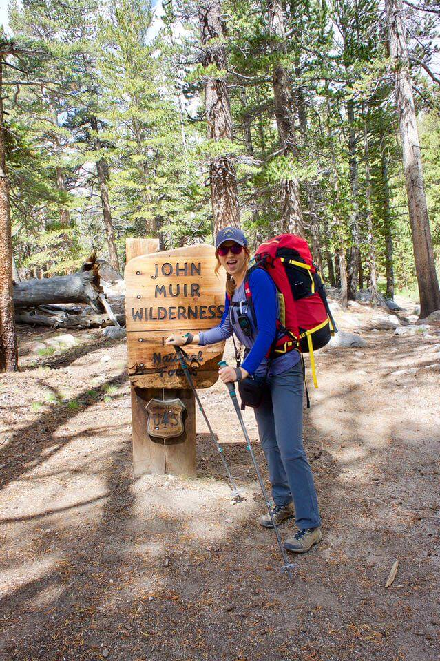 Allison standing by the John Muir Wilderness Sign on the Cottonwood Lakes Trail.