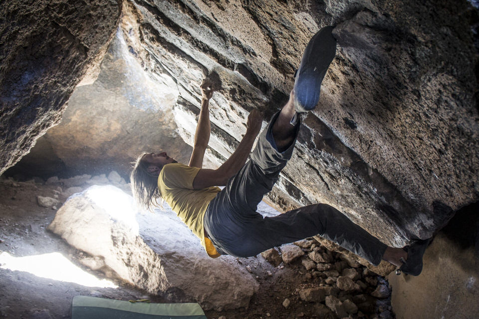 Rock climbing in a cave.