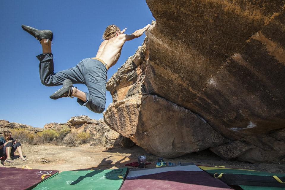 Rock Climber doing a dyno.