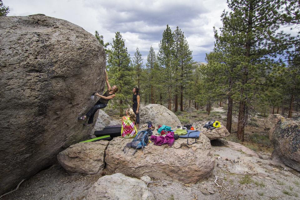 Girl rock climbing outdoors.