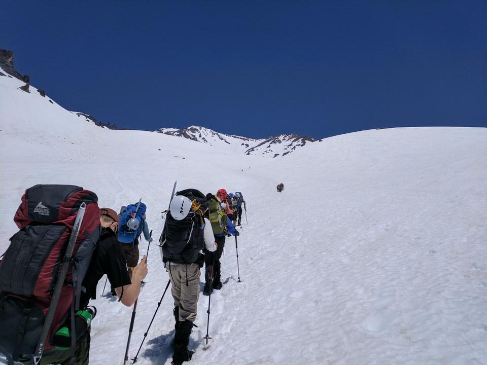 Group of climbers climbing Mount Shasta.