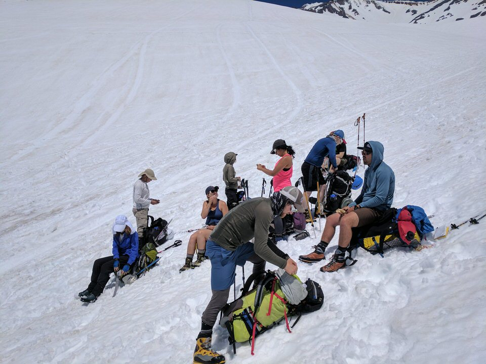 Resting on our way up the Avalanche Gulch Route.