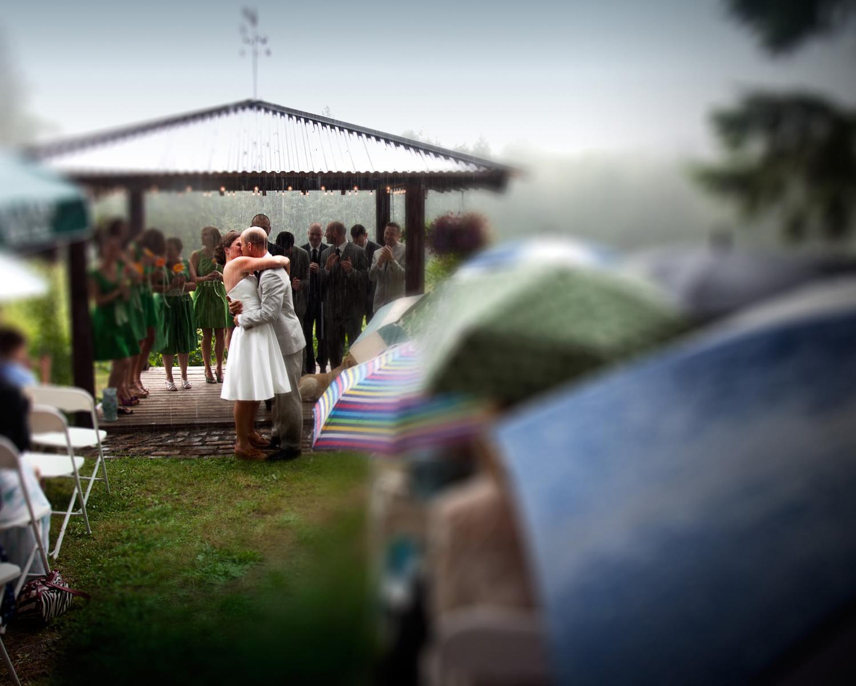 SFL_Sara_Jeff_Wedding_Rain_Kiss.jpg