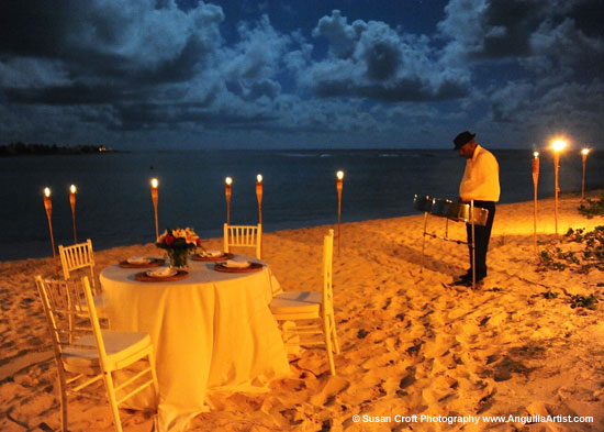 """The  evening Orion proposed to Kate. Starry sky, candlelight, steel drums, champagne, and a dessert cake with their initials """"O&K"""" on it.    Susan Croft Photography"""