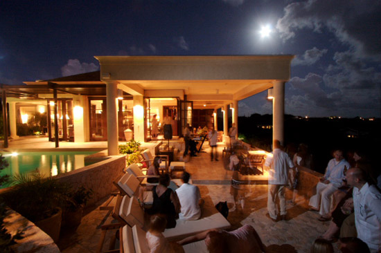 Wedding reception and dance on the front verandah overlooking the nighttime Caribbean Sea. Conrad Erb Photography