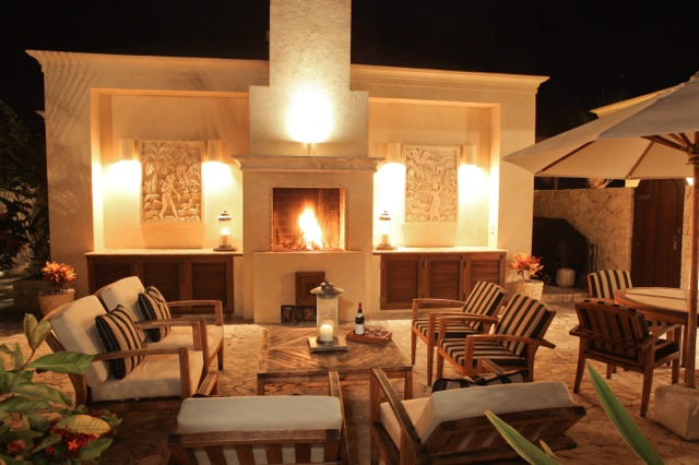 Living area shown at night with fire and candles for romantic, luxury vacation