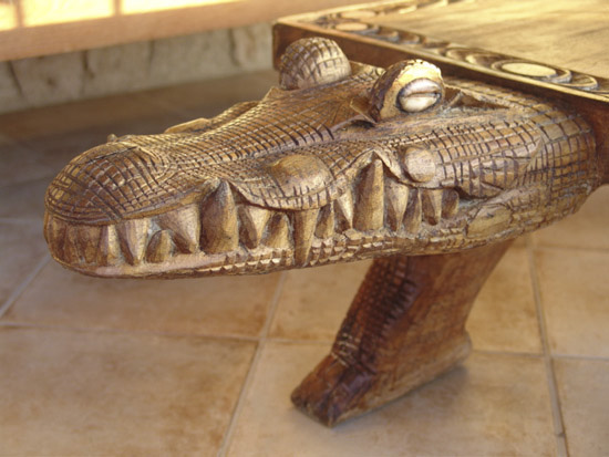 Detail of carved crocodile head which is part of patio table (Papua New Guinea)