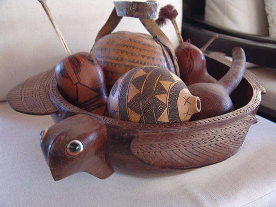 Various gourds and lime juice holders (Africa and Papua New Guinea)in a carved turtle bowl from Papua New Guinea.