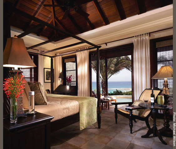Bedroom with view of verandah, plunge pool, and Caribbean Sea